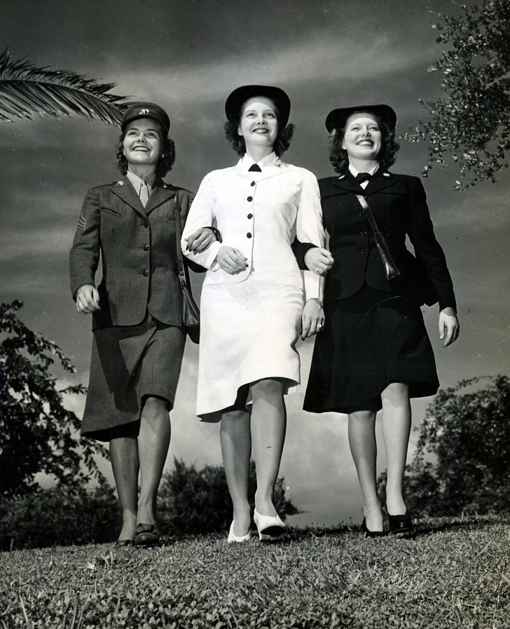 A female WAVE, Marine, and Coast Guard member each in their uniforms, 1943.