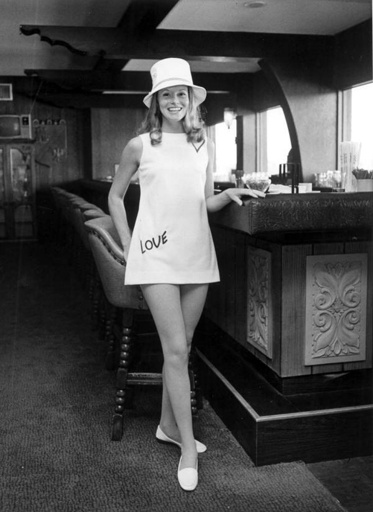 1969 fashion model wearing a minidress and bucket hat