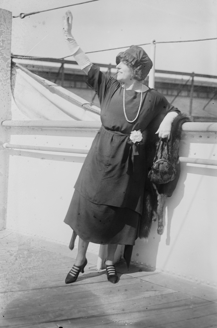1910s woman waving from a steam ship