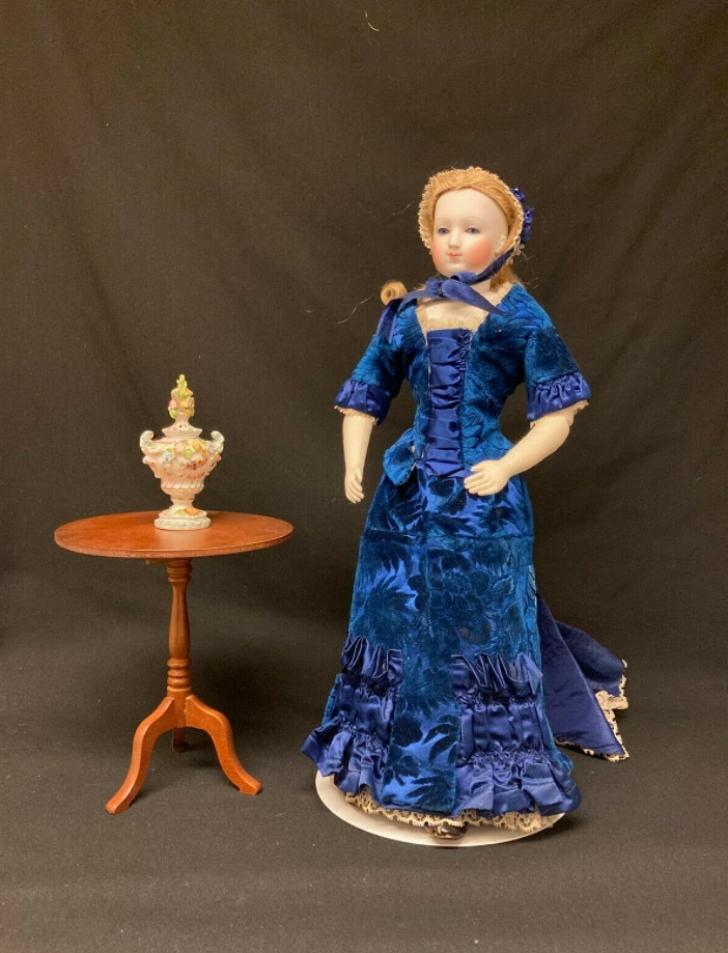 1870s fashion doll in blue velvet dress