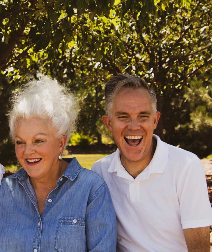 gray hair couple laughing together