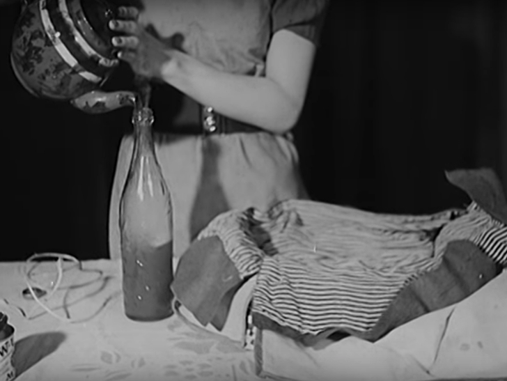 woman pouring hot tea into a glass bottle