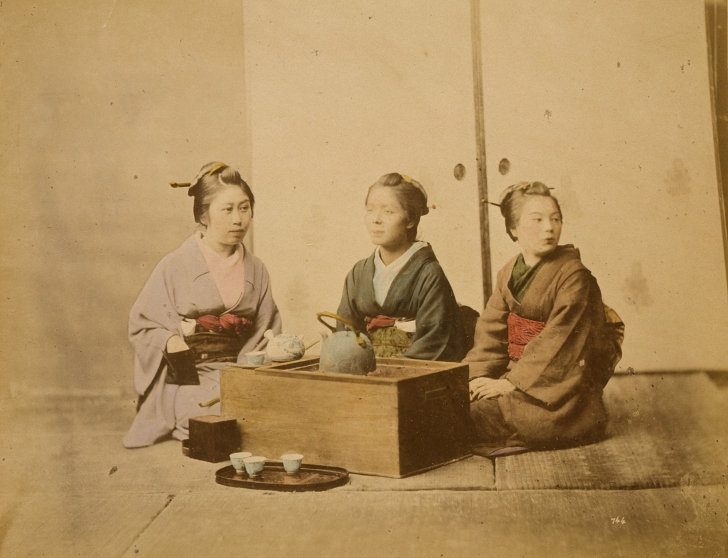 colorized photo of 3 Japanese women having tea from 1877