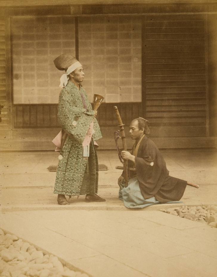 samurai kneeling before a government official in Japan, 1877