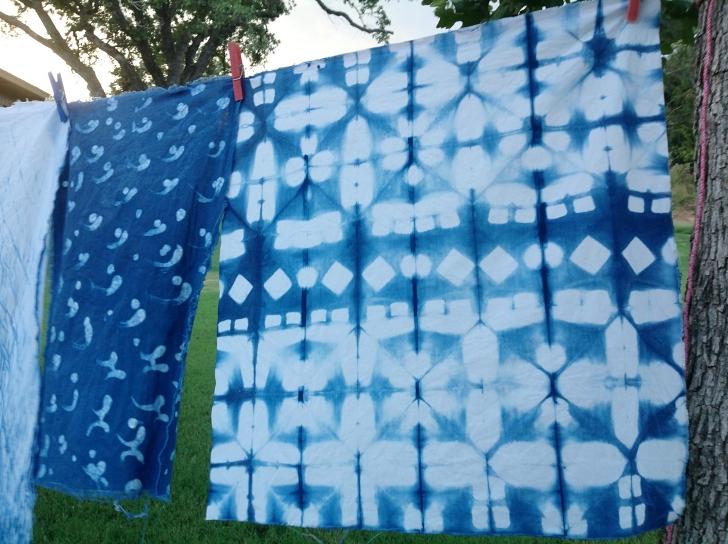 shibori cloth drying on a line outside