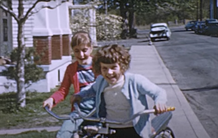 children riding their bikes in the 1950s