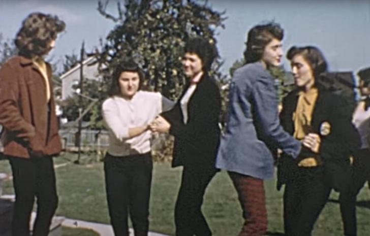 women partner dancing outside, 1950s