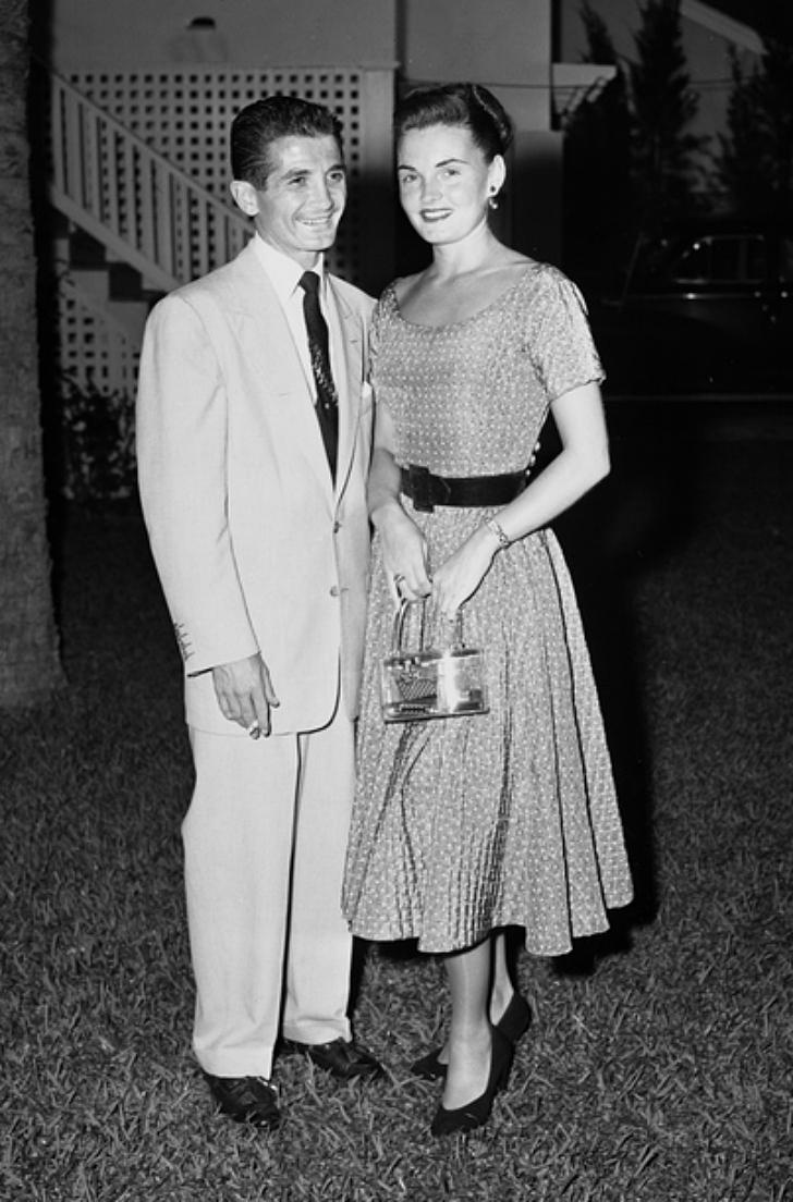 woman holding an acrylic handbag, 1950