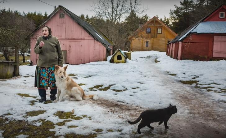 Kihnu woman on her farm, Estonia