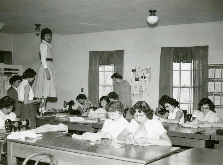 girls learning sewing in school