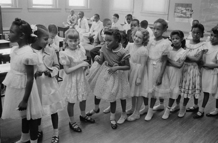 school girls each in a frilly dress and mary janes shoes
