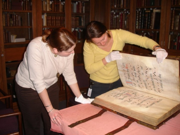giant manuscript handled with gloves