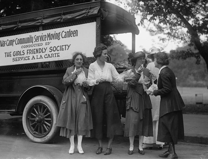 WWI women wearing pants at a WWI canteen wagon