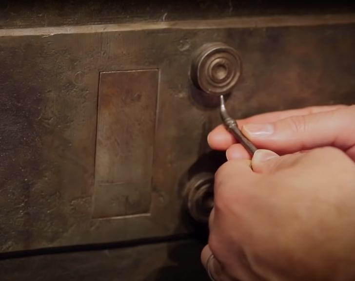 secret mechanisim on a baroque era strong box