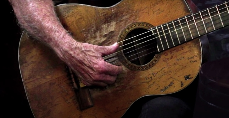 Willie Nelson playing his guitar, Trigger