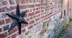 6 point star on historic brick building