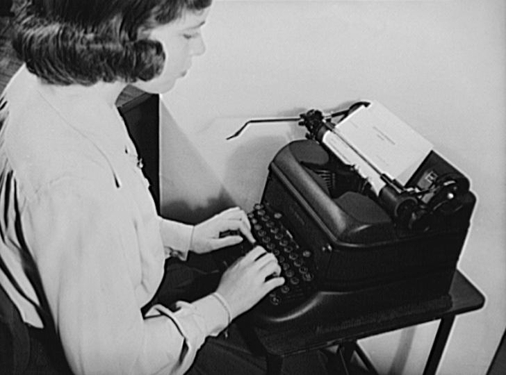 female secretary at typewriter