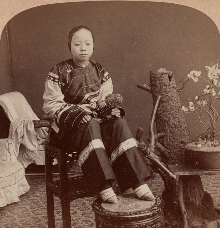 Chinese woman with bound feet circa 1900