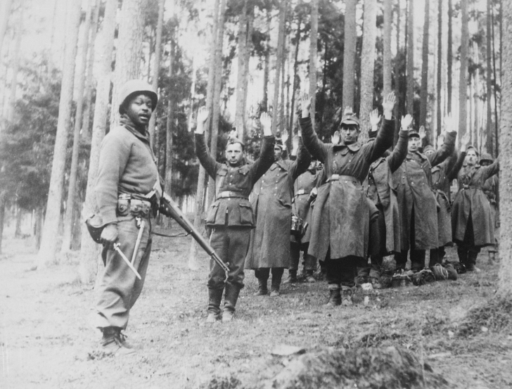 African American soldier with surrendering Germans WWII