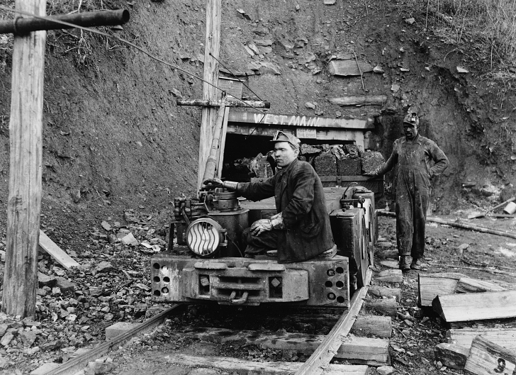 early 20th century coal miners removing coal from shaft