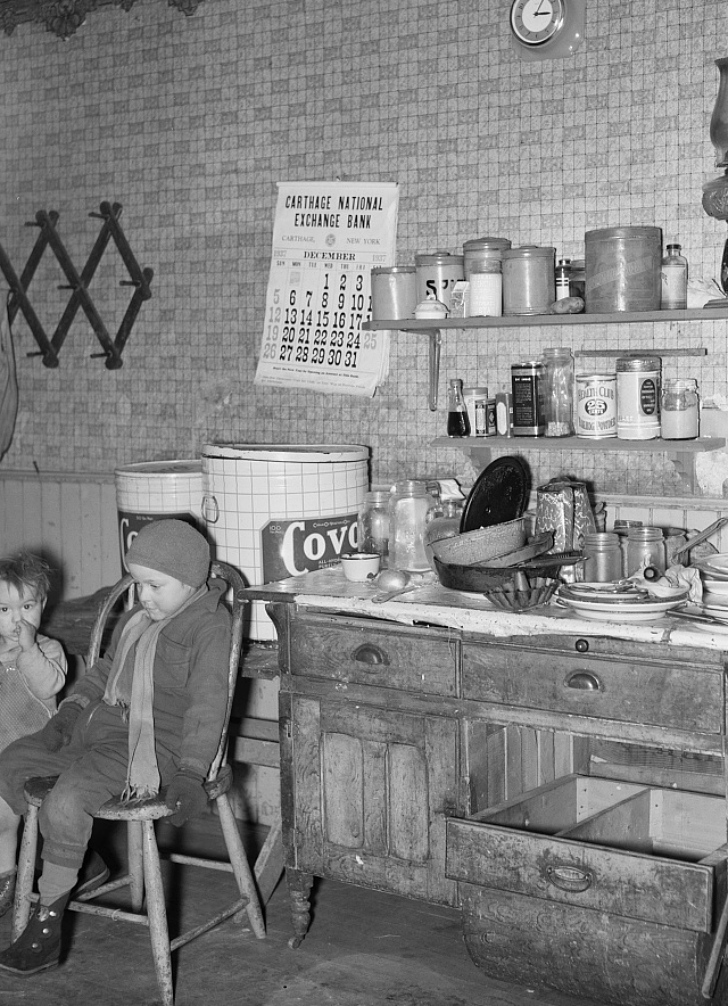 1937 kitchen with kids sitting in chairs
