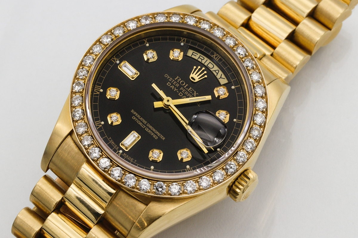 18K gold Rolex with both day and date dials
