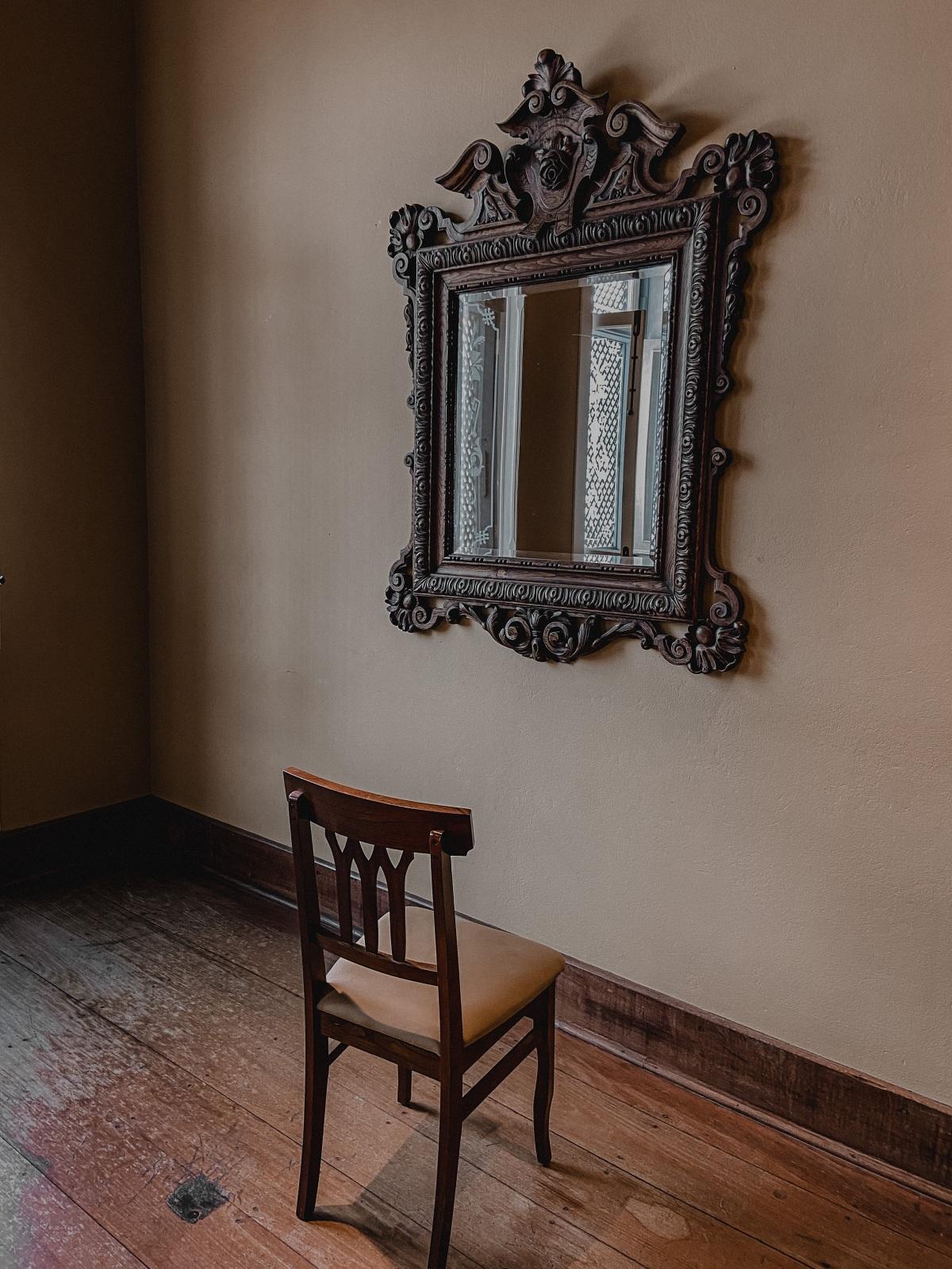 empty chair facing a mirror