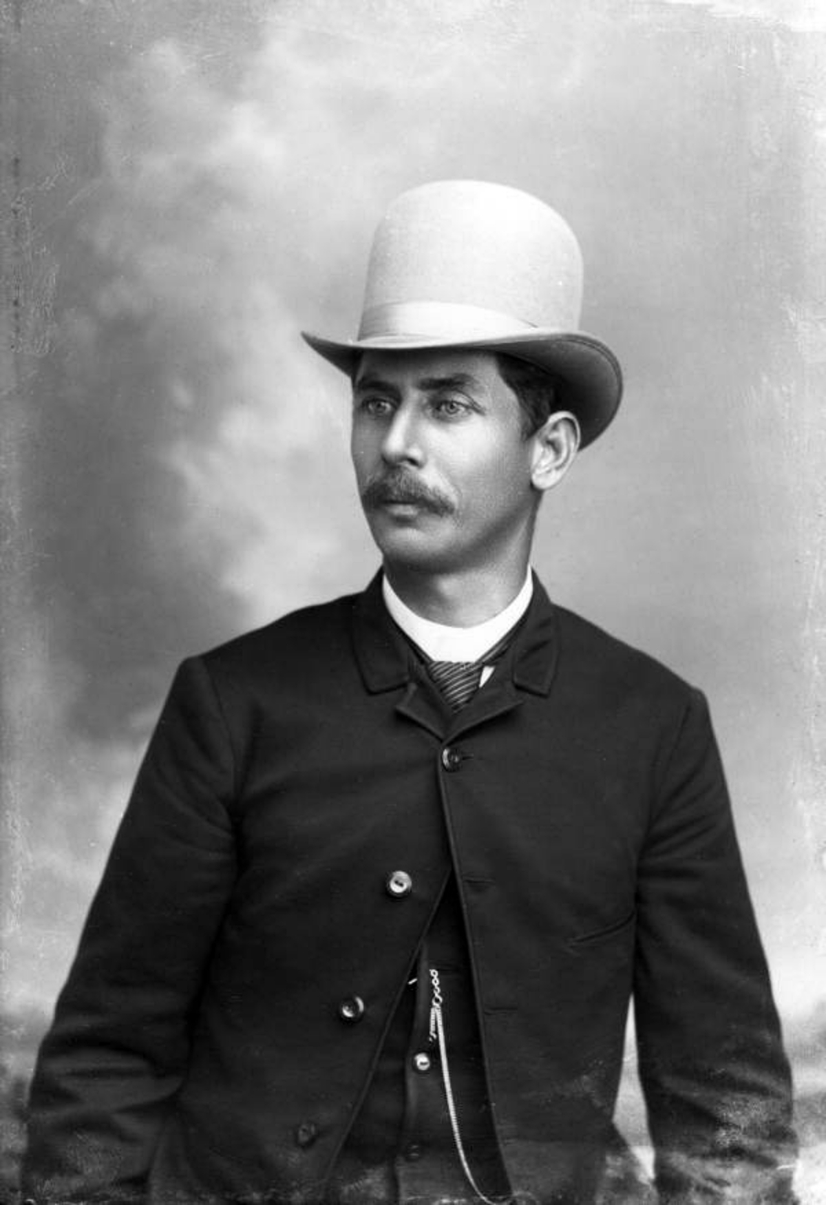 1890s man with mustache and big hat