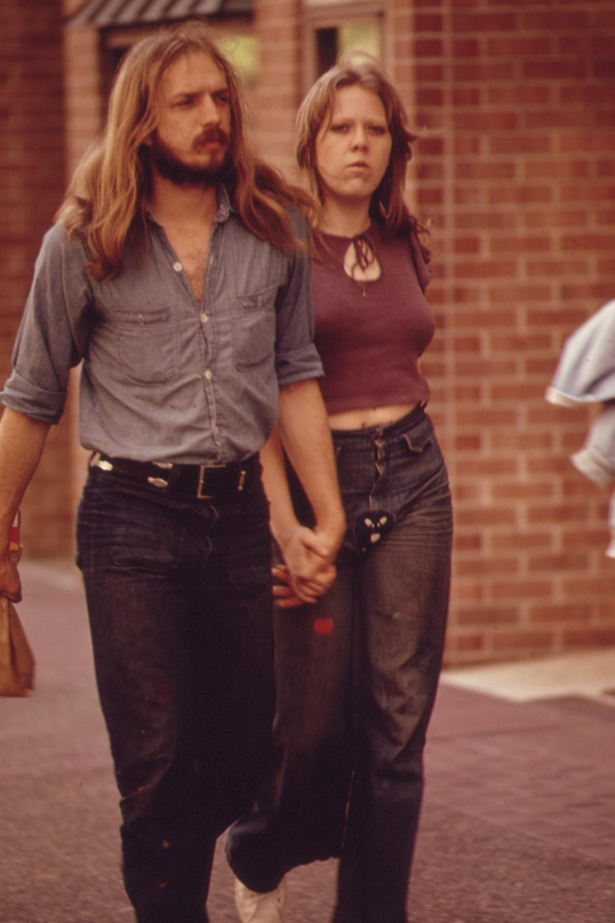 1970s couple walking hand in hand