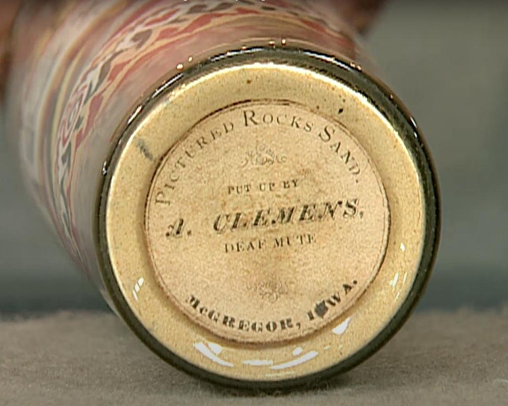 label on bottom of antique sand art bottle
