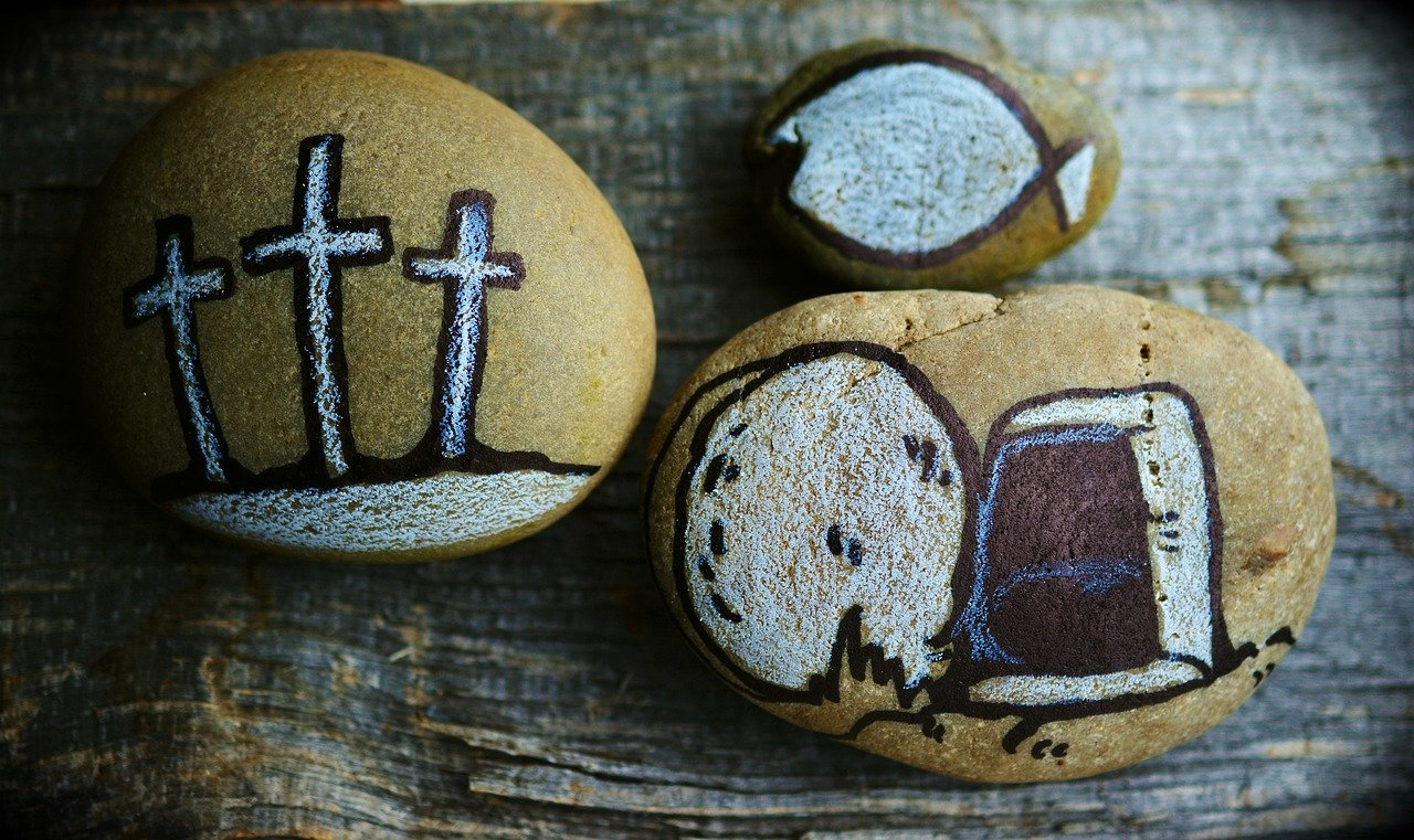 stones with crosses painted on them