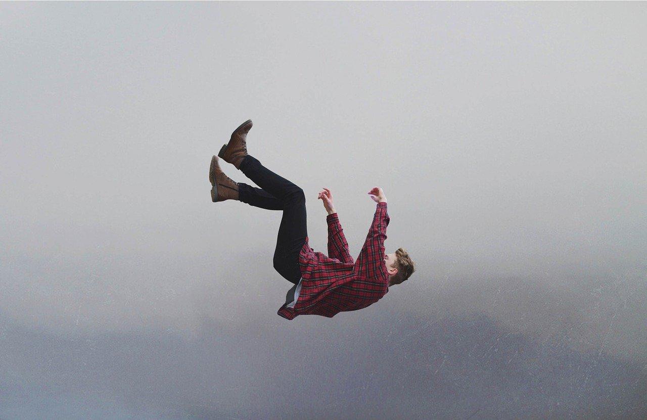 man falling off edge