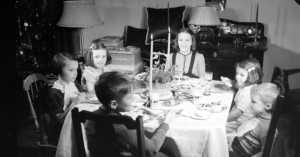 children having Christmas dinner, 1938