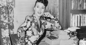 Gypsy Rose Lee at her typewriter, 1956